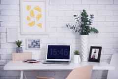 Comfortable workplace with laptop. In office Royalty Free Stock Photos