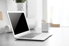 Comfortable workplace with laptop. In office Stock Images