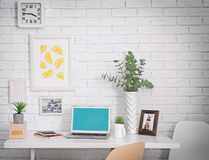 Comfortable workplace with laptop. In office Stock Photography
