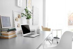 Comfortable workplace with laptop. In office Royalty Free Stock Photography