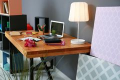 Comfortable workplace with laptop. On table Stock Images