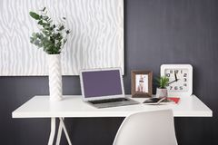 Comfortable workplace with laptop. In office Stock Photo