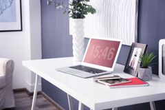 Comfortable workplace with laptop. In office Royalty Free Stock Image