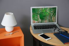 Comfortable workplace with laptop. On table Stock Photography