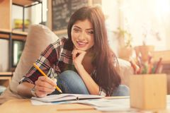 Radiant girl in casual working from home Stock Photography