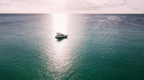 Yacht trip in the Caribbean sea. A comfortable yacht in the sunset sun of the Caribbean Sea. There are no waves. There is no wind royalty free stock images