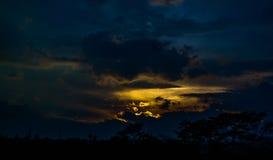 Comfortablemente entumecido vea la puesta del sol hermosa Foto de archivo libre de regalías