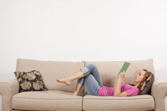 Comfortably Reading a Book stock image