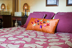 Comforter on bed in room. Purple flower comforter on bed in bedroom Royalty Free Stock Photography