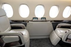 Comfortible cabin chairs in a modern business jet aircraft durin royalty free stock image