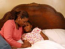 Comforting. A mother comforts her sick daughter Royalty Free Stock Photography