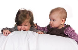 Comforting another baby. Caring four month old baby comforting a crying child Stock Image