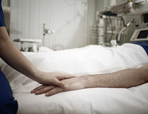 Comforting of critically ill patient in intensive care Royalty Free Stock Photo