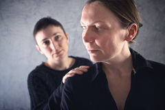 Comforting friend. Woman consoling her sad friend. Royalty Free Stock Photo