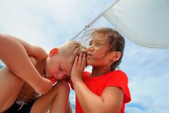 Comforting a friend. Young girl hugs her adorable boy Stock Photo