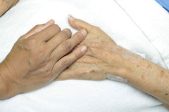 Comforting Hand. Woman Comforting ,Hand with Old woman Stock Images