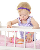 Comforting Her Baby Doll Royalty Free Stock Images