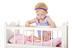 Comforting Her Baby Doll Royalty Free Stock Image