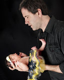Comforting His Crying Newborn Royalty Free Stock Photo