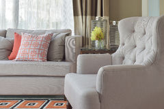 Comfy armchair with chinese style in orange theme living c. Comfy beige armchair with chinese style in orange theme living corner Stock Photo