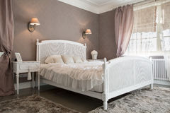 Comfy bedroom inside a residence. View of comfy bedroom inside a residence Stock Photo