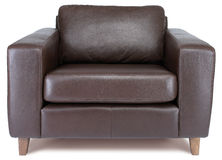 Comfy brown leather armchair on a white background. A comfy brown leather armchair on a white background Royalty Free Stock Images