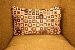 Comfy cushion. A soft comfortable cushion on an armchair stock photo