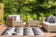 Garden furniture and rug. Comfy garden furniture and geometrical rug on a terrace in spa resort royalty free stock images