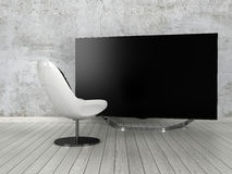 Comfy modern chair in front of a flat screen TV Stock Image