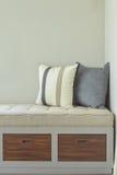 Comfy seat with storage next to window. Pillows on comfy seat with storage next to window Royalty Free Stock Photos