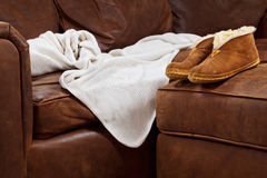 Comfy sofa blanket slippers Royalty Free Stock Photo