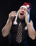 Comic actor man in cap with braids with a glass of vodka, in anticipation of Christmas and New Year Stock Photography