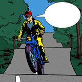 Comic book motorcyclist with speech bubble Royalty Free Stock Photography