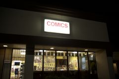 Comic Book Shop. A comic book store sells comic magazines from marvel and dc comics such as superman, batman, robin, wonder woman green lantern, wolverine Stock Photography