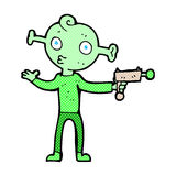 comic cartoon alien with ray gun Royalty Free Stock Image