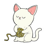 Comic cartoon cat playing with ball of yarn Royalty Free Stock Images