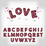 Comic cartoon chocolate with candy heart alphabet Stock Photography