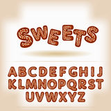 Comic cartoon chocolate nuts candy style alphabet Stock Photo