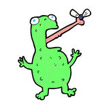 comic cartoon frog catching fly Royalty Free Stock Image