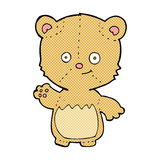 Comic cartoon little teddy bear waving. Retro comic book style cartoon little teddy bear waving Stock Photo