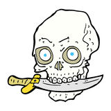 Comic cartoon pirate skull with knife in teeth Royalty Free Stock Photography