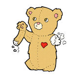Comic cartoon teddy bear with torn arm Stock Image
