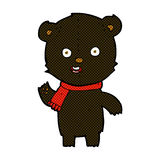 Comic cartoon waving black bear cub with scarf Royalty Free Stock Photography