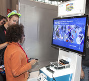 Comic Con 2013. NEW YORK - October 13: Fan tries new game  from Wii during Comic Con 2013 at The Jacob K. Javits Convention Center on October 13, 2013 in New Royalty Free Stock Image