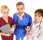 Comic doctor with his team Stock Photography