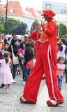 Comic entertainer on stilts Stock Images