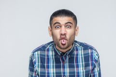 Comic faces concept. Funny hipster showing stupid face and looki Stock Photos