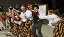 Comic folk dance - love story stock photos