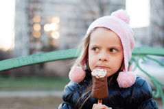 Comic girl eating ice cream Royalty Free Stock Image