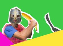 Comic knight with a banana instead of a sword is protected from a fictional enemy. Masculine joke royalty free stock images